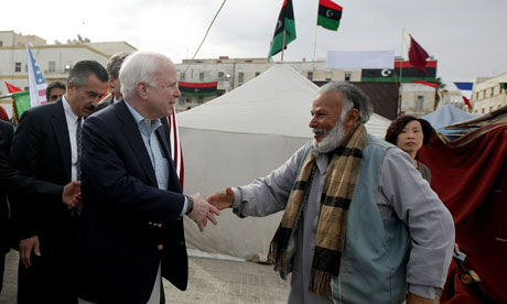John McCain meets a Libyan rebel in Benghazi
