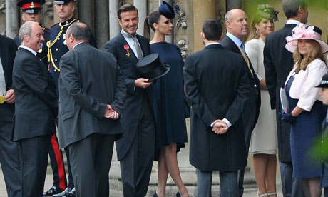 David and Victoria Beckham arrive for the royal wedding at Westminster Abbey in London