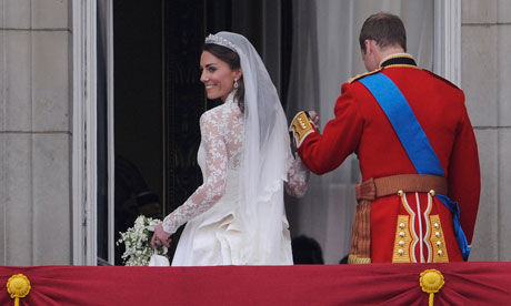 Kate Middleton looks back to the crowd after her kiss with Prince William at Buckingham Palace