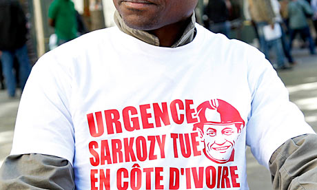 A pro-Gbagbo protester wears a shirt declaring 'Emergency Sarkozy kills in Ivory Coast'
