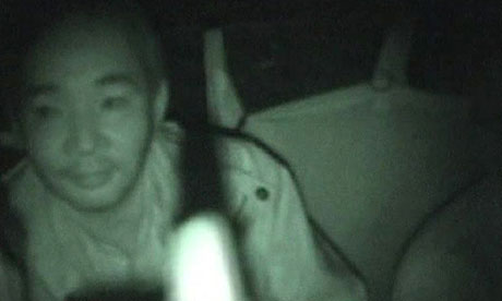 Yoshifumi Okamura inside helicopter after rescue from Abidjan, Ivory Coast