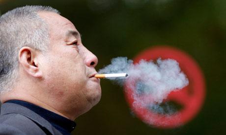 A man smokes next to a