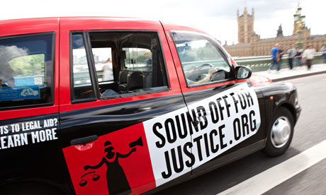 A taxi with a Sound Off For Justice advertisement