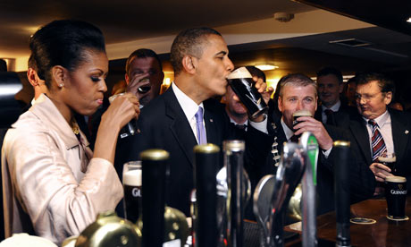 Barack Obama and Michelle Obama sip Guinness at a pub as they visit Moneygall, Ireland