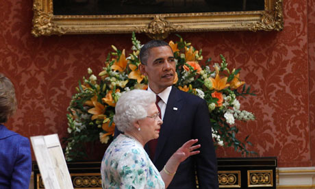 Barack Obama talks with the Queen as they tour the Buckingham Palace portrait gallery on 24 May 2011