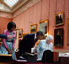 Barack and Michelle Obama talk with the Queen and Prince Philip as they tour Buckingham Palace