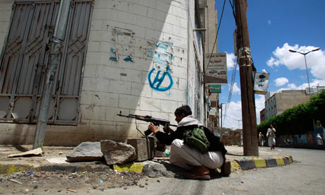 A tribesman takes a position near Sheikh Sadiq al-Ahmar's house during clashes with police in Sana'a