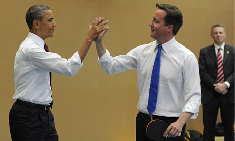 Barack Obama and David Cameron play table tennis at Globe Academy, London, on 24 May 2011.