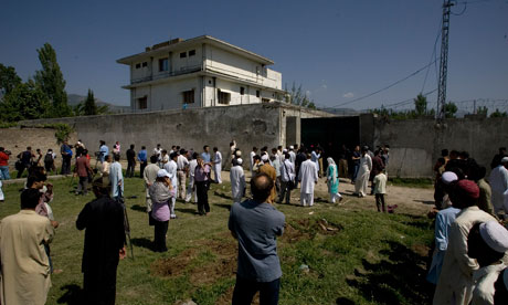 Local people and media gather outside the compound where bin Laden was killed in Abbottabad Pakistan