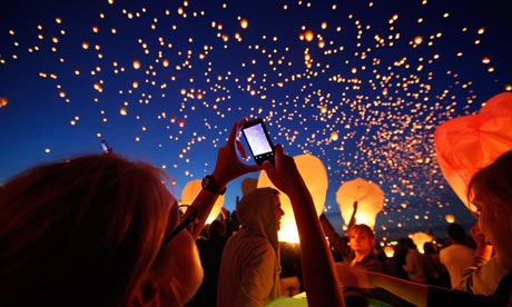 People launch Chinese lanterns during Kupala Night in Poznan, Poland