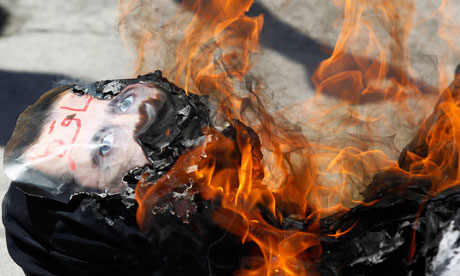 Demonstrators set fire to an effigy of Bashar al-Assad during a protest in Istanbul on 24 June 2011