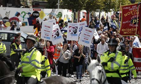 Protesters march through Liverpool as part of a one day national strike