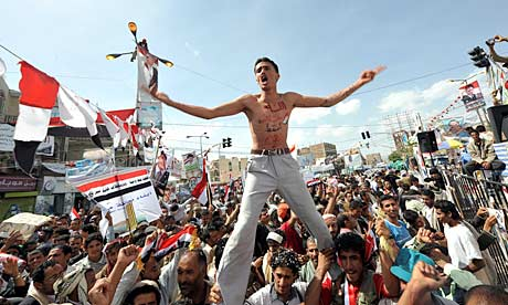 Yemenis celebrate the exit of President Ali Abdullah Saleh to Saudi Arabia for medical treatment