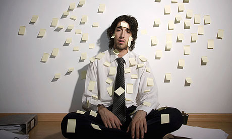 Businessman covered in sticky notes