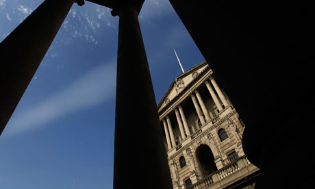 The Bank of England is seen between pillars in the City of London