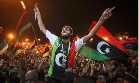 People celebrate at the rebel-held town of Benghazi, Libya