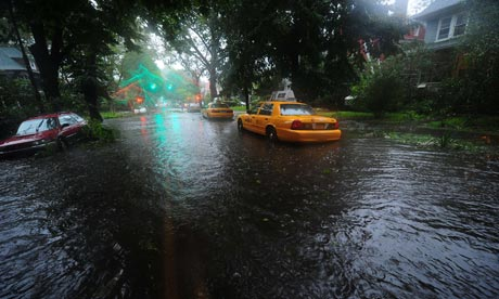 A taxi stands in flood water as Hurricane Irene hits in Brooklyn