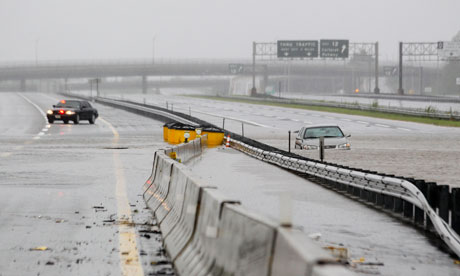 An abandoned car at the New Jersey Turnpike as floodwaters from Hurricane Irene cover the road