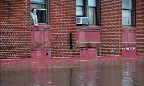 A resident looks at floodwater on Coney Island after Hurricane Irene hit