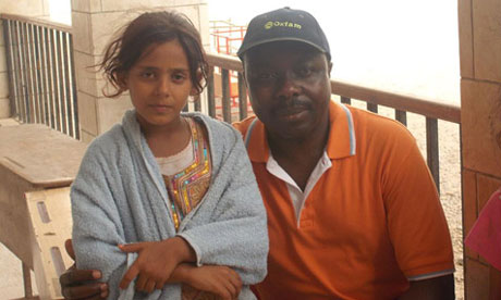 Oxfam's humanitarian co-ordinator Kitka Goyol with Zykra Abdullah, aged 11, Aden