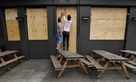 People board up a pub in central London