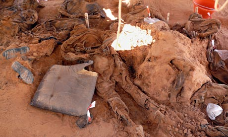 Bodies exhumed from a mass grave near al-Qawalish, Libya