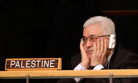 Mahmoud Abbas listens to Barack Obama speak in New York