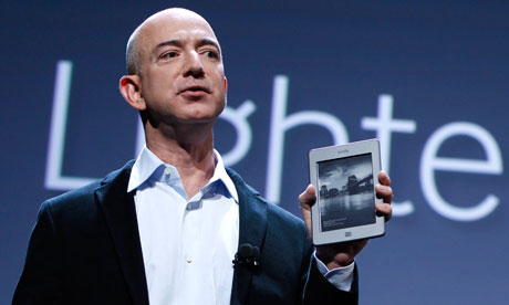 Amazon CEO Jeff Bezos holds up the new Kindle Touch