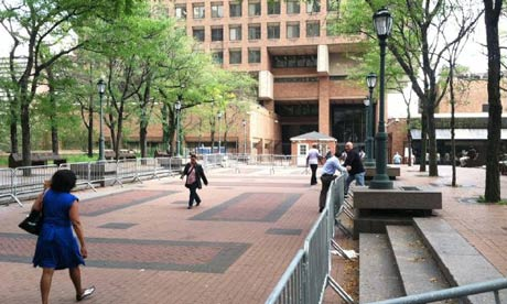 Barriers are erected outside New York police department HQ before an Occupy Wall Street march