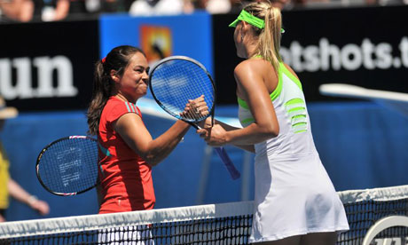 Maria Sharapova, right, dropped a single game in seeing off Jamie Hampton of the US