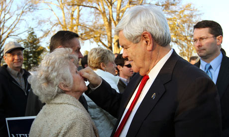Newt Gingrich pinching a lady's nose