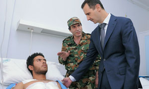 Bashar al-Assad, during his visit to wounded troops