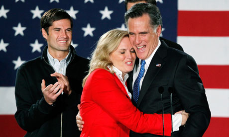 Republican presidential candidate Mitt Romney hugs his wife Ann