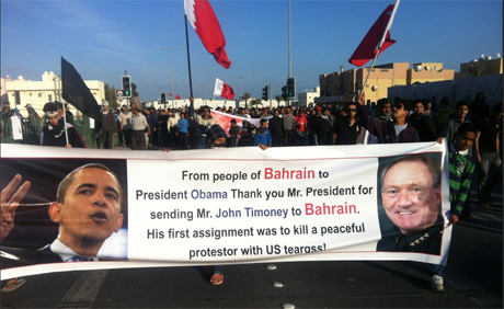Bahrain protesters hold Obama and Timoney banner