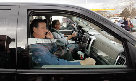 Rick Santorum is driven away from a campaign stop in Tilton, New Hampshire