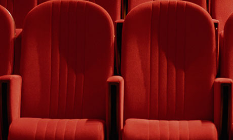 Two empty red seats in theater