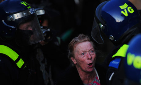 A Traveller confronts riot police as they prepare to make evictions from Dale Farm in October 2011