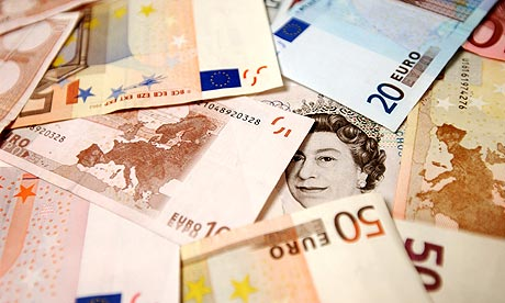 A close up of a Sterling note surrounded by Euro notes