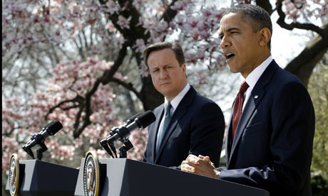 US president Barack Obama peaks while British Prime Minister David Cameron listens