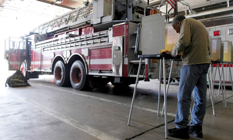 Illinois voters go to the polls at a fire station