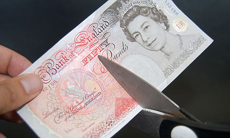 Fifty pound note being cut with scissors.. Image shot 2009. Exact date unknown.