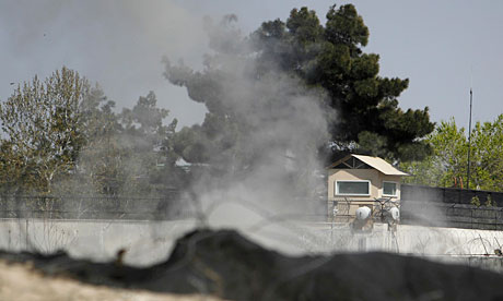 Smoke rises from a tower at the British embassy in Kabul