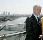 Ken Livingstone in front of Canary Wharf.