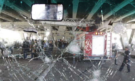 A view through the damaged windshield of a bus after a bomb exploded in central Damascus