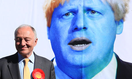 Ken Livingstone standing next to a campaign poster attacking Boris Johnson on 30 April 2012.