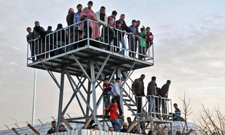 Syrian refugees watch the border from Oncupinar Refugee Camp in Kilis
