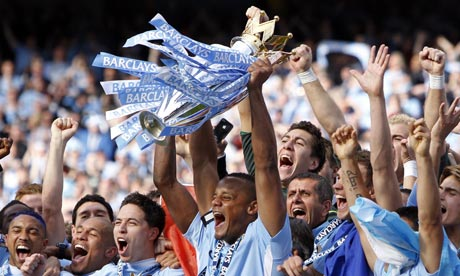 Man City players lift the trophy