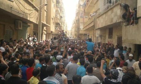 Demonstrators protest against Syria's president Bashar al-Assad in Deir Ezzor on 15 May 2012.