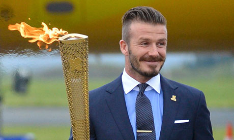 David Beckham carries the Olympic torch