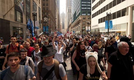 Demonstrators march through the streets in Chicago ahead of the Nato summit.